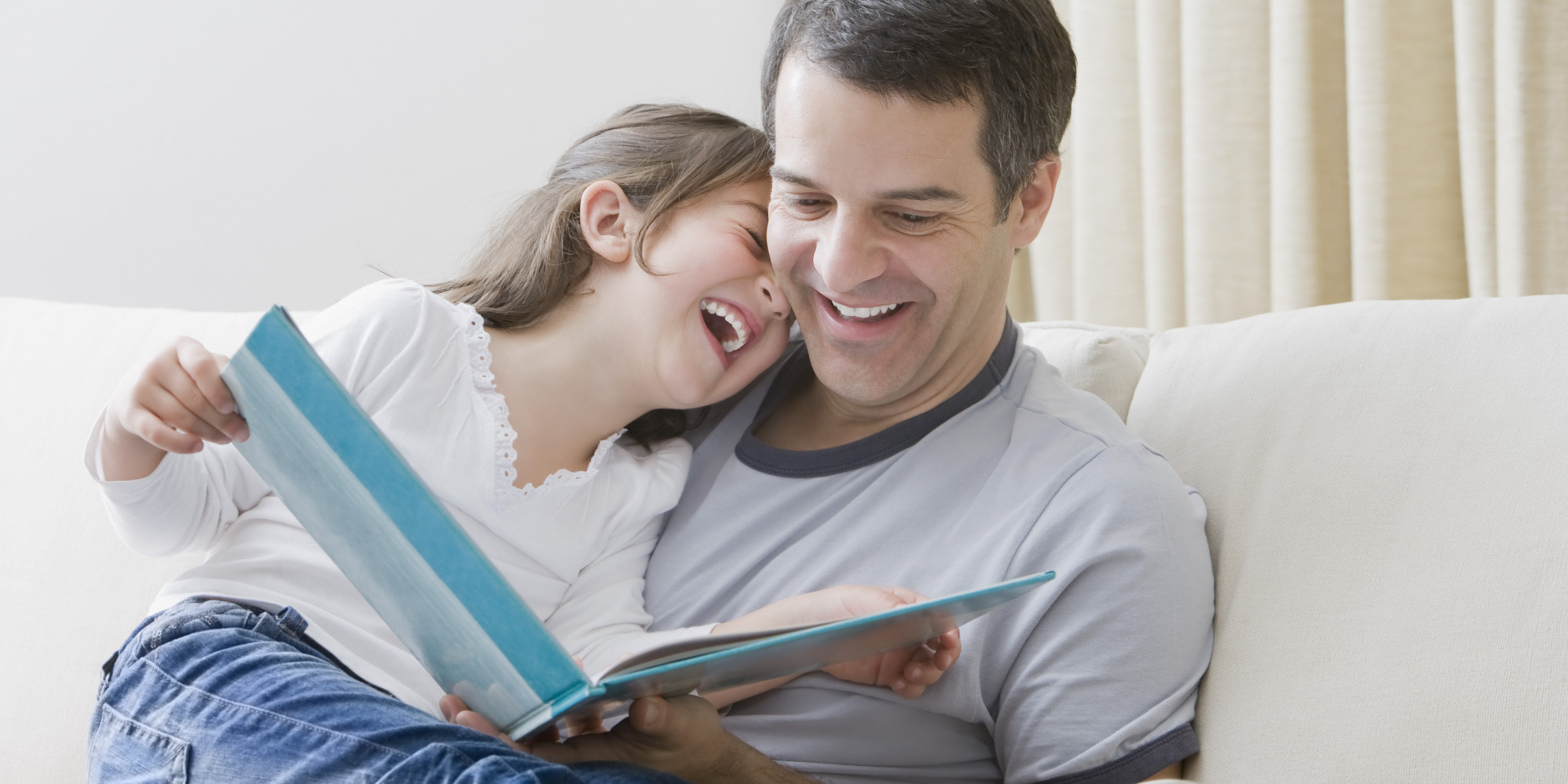 dad reading to daughter