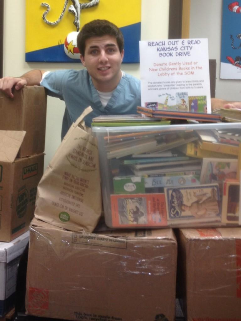 Reid Waldman, med student at UMKC with 750 book donation 2015