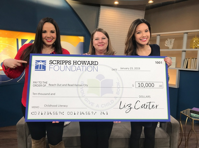 Photo of Jenny, Kelly and Crystle Lampitt with Big check donation from KC Live - credit KC Live